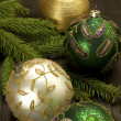 Christmas decorations with candles and christmas baubles — Stock Photo