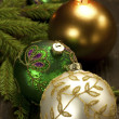 Christmas decorations with candles and christmas baubles — Stock Photo #35133431