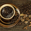 Black coffee with spices — Stock Photo