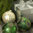 Christmas composition with gift box and christmas baubles — Stock Photo