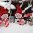 Happy snowman friends in drifts — Stock Photo