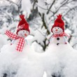 Happy snowman friends in drifts — Stock Photo