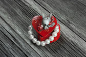 Valentines Day heart-shaped gift box with pearl — Stock Photo