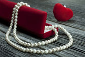 Romantic gift into jewelry box, valentine's day — Stock Photo