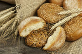 Freshly baked traditional bread on wooden board — Stock Photo