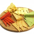 Various types of cheese on a wooden board — Stock Photo #40029611
