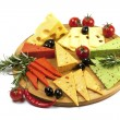 Various types of cheese on a wooden board — Stock Photo #40029615