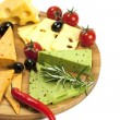 Various types of cheese on a wooden board — Stock Photo #40029633