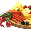 Various types of cheese on a wooden board — Stock Photo
