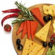Stock Photo: Various types of cheese on a wooden board