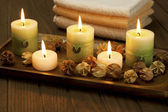 Spa candles with dried flowers — Stock Photo