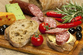 Bread with smoked salami and cheese cream — Stock Photo