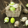 Easter eggs in the vintage box on rustic wooden surface — Stock Photo #41467131