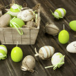 Easter eggs in the vintage box on rustic wooden surface — Stock Photo #41467135