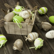 Easter eggs in the vintage box on rustic wooden surface — Stock Photo #41467139