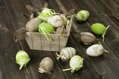 Easter eggs in the vintage box  on rustic wooden surface — 图库照片