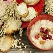 Oatmeal porridge with raspberry and raisins in a bowl — Stock Photo
