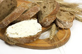 Freshly baked traditional bread with butter cream — Foto de Stock