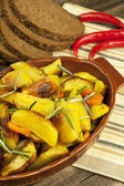 Potatoes baked in  oven with spices and rosemary — Stock Photo