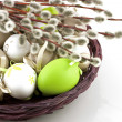 Easter still life with colorfull eggs  in  wicker  basket — Stock Photo #43703009