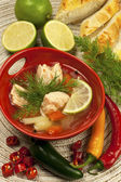 Fish soup with potato and carrots — Stock Photo