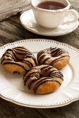Fresh homemade Donuts and tea — Stock Photo