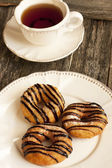 Fresh homemade Donuts and tea — Stock Photo
