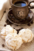 Meringue cookies and cup of aromatic coffee — Stock Photo