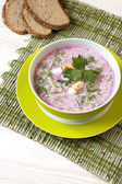 Traditional  Russian cold  soup made of beets, cucumbers and herbs with egg and sour cream — Stock Photo