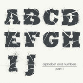 Ragged grunge alphabet with ink splatter — Stock Vector