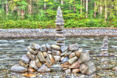 Stone tower in the mountain river — Stock fotografie