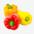 A mix of differently colored bell peppers isolated on white back — Stok fotoğraf
