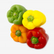 Stock Photo: A mix of differently colored bell peppers isolated on white back