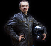 Adult motorcyclist in brown leather jacket. — Stock Photo