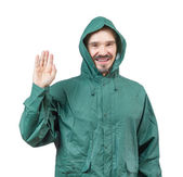 Caucasian man in hooded rain suit waiving with palm isolated on — Stock Photo