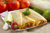 Mexican tamales on plate. — Stock Photo