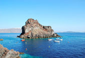 Rocky promontory in Amoudi bay — Stock Photo