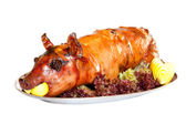 Grilled suckling pig on a plate — Stock Photo