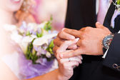The bride dresses a wedding ring to the groom — Stock Photo