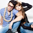 Sexy man and woman doing a fashion photo shoot in a professional studio — ストック写真 #21434881