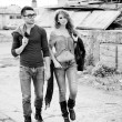Stock Photo: Sexy and stylish young couple wearing jeans (Photo has intentional film grain)