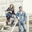 Stock Photo: Attractive fashionable couple wearing jeans posing dramatic - retro processed image
