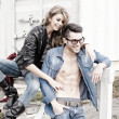 Stock Photo: Stylish couple wearing jeans and boots smiling - retro processed image