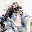 Stylish couple wearing jeans and boots smiling - retro processed image — Stock Photo #21435009