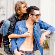 Stockfoto: Attractive fashionable couple wearing jeans posing dramatic - retro processed image
