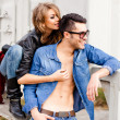 Foto Stock: Attractive fashionable couple wearing jeans posing dramatic - retro processed image