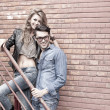 Sexy and fashionable couple wearing jeans, shoot in a grungy location - landscape orientation with copy-space — Stock Photo #21435337