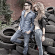 Sexy and fashionable couple wearing jeans, shoot in a grungy location - landscape orientation with copy-space — Stock Photo #21435371