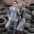 Sexy and fashionable couple wearing jeans, shoot in a grungy location - landscape orientation with copy-space — Stock Photo #21435391