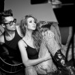 Sexy man and woman doing a fashion photo shoot in a professional — Stock Photo